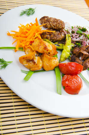 Plate with tasty lamp kebabs photo