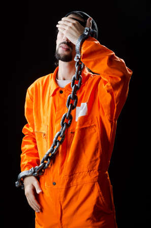 Inmate chained on black background Stock Photo - 11156640