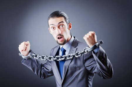 Businessman handcuffed for his crimes Stock Photo - 11404185