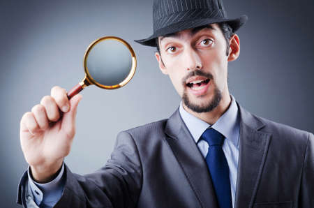Detective and magnifying glass photo
