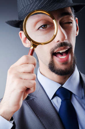 private investigator: Detective and magnifying glass Stock Photo
