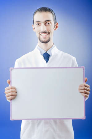Doctor with blank message board Stock Photo - 11156516