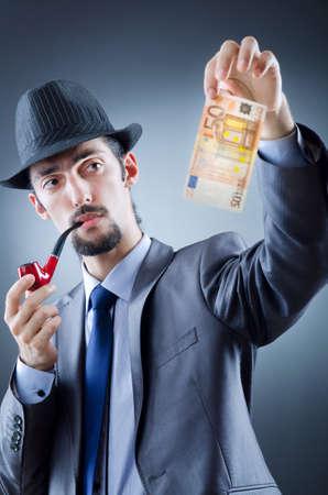 Detective looking at fake money photo