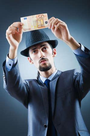 fake money: Detective looking at fake money