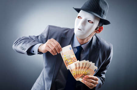 fraud: Businessman with money and mask Stock Photo