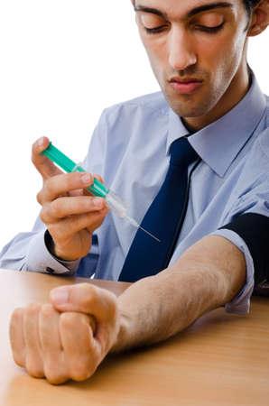 Drug addict injecting drugs photo
