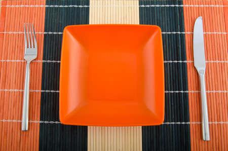 Food utensils on the mat photo