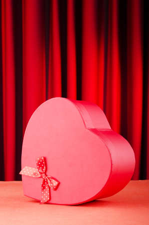 Heart shaped gift box against background photo