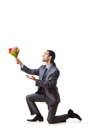 Businessman offering tulip flowers photo