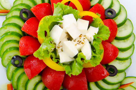 Cucumber and tomato salad in plate photo