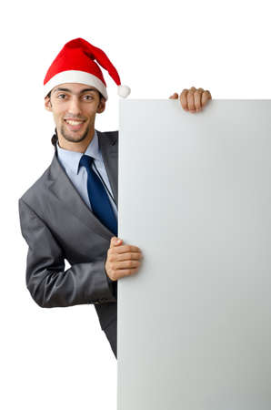 Businessman in santa hat with blank message photo