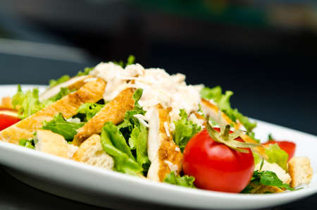 Ceasar salad served in restaurant photo