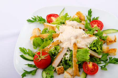 Ceasar salad served in the plate photo