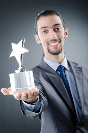 Businessman awarded with star award photo