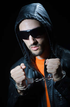 Young criminal with handcuffs Stock Photo - 11193548
