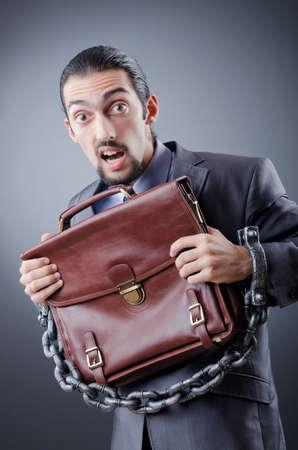 Arrested businessman in studio shooting photo