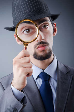 inquiring: Detective and magnifying glass Stock Photo