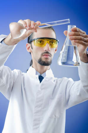 Young chemist student working in lab photo
