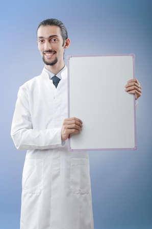 Doctor with blank message board photo