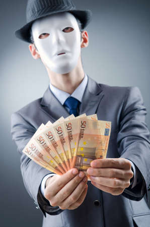 Businessman with money and mask Stock Photo - 11181294