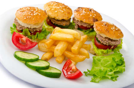 Plate with burgers and french fries photo