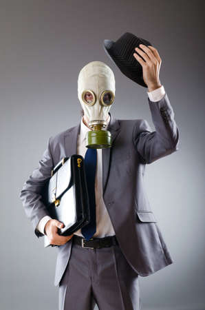 Businessman wearing gas mask photo