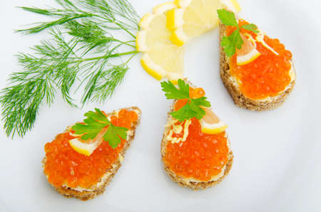 Red caviar served in the plate photo