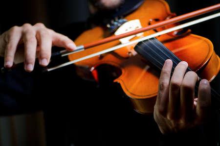 fiddlestick: Violin player playing the intstrument