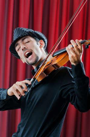 virtuoso: Violin player playing the intstrument