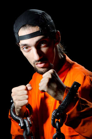 Inmate chained on black background Stock Photo - 11250942
