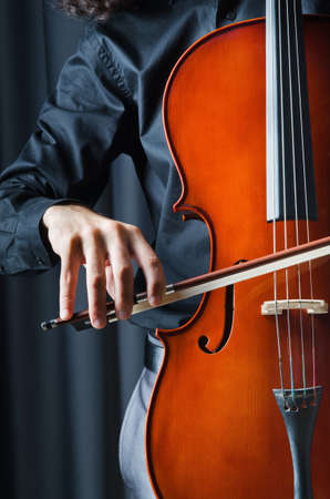 fiddlestick: Man playing the cello Stock Photo