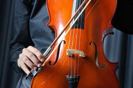 Man playing the cello photo