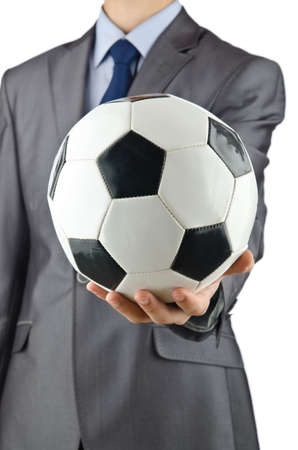 Businessman holding football on white photo