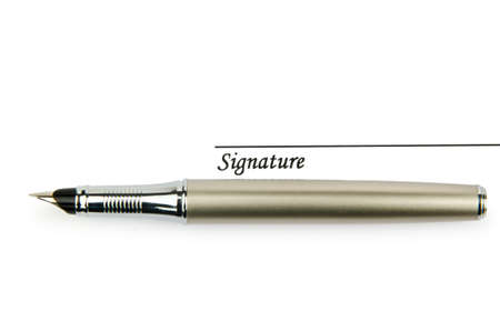 Pen and signature isolated on white photo