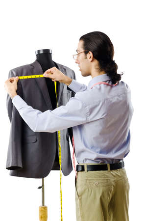 tailor measuring tape: Tailor working isolated on white Stock Photo