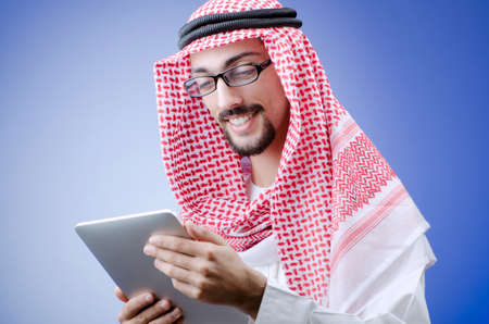Young arab with tablet computer photo