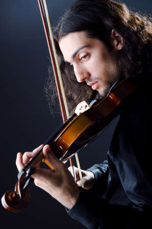 Young violin player playing photo
