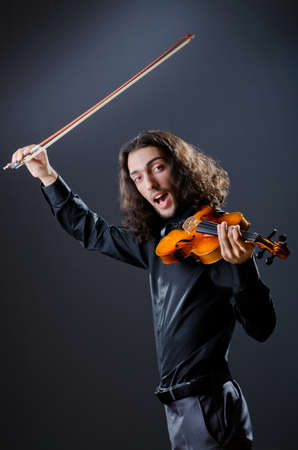 solo violinist: Violin player playing the intstrument