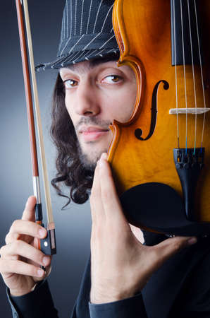 violin player: Gypsy violin player in studio Stock Photo