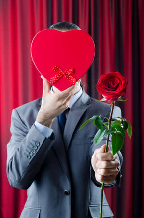 Young man with red rose photo