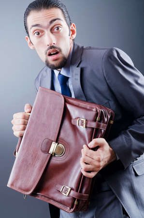 corporate espionage: Business spy with briefcase