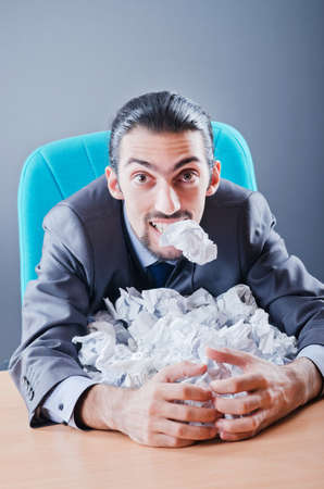 Businessman throwing paper away Stock Photo - 11572419