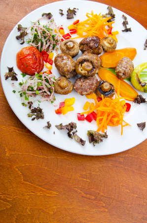 Kebab served in the plate photo