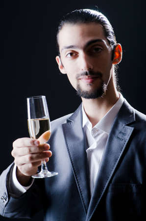 Man tasting wine in glass photo