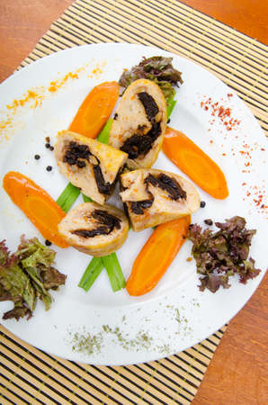 Meat and vegetable roll in plate photo