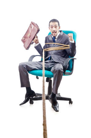 Businessman in the tug of war concept photo