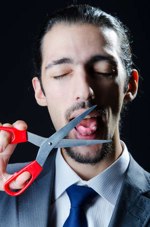 corporate espionage: Cutting tongue with scissors Stock Photo
