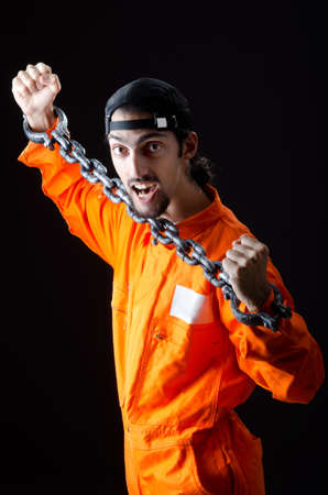 Inmate chained on black background Stock Photo - 11418449