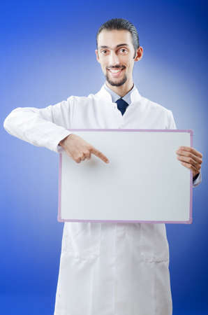 Doctor with blank message board Stock Photo - 11572383