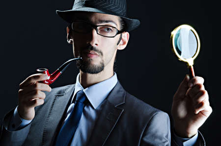 sherlock: Detective with magnifying glass and pipe Stock Photo
